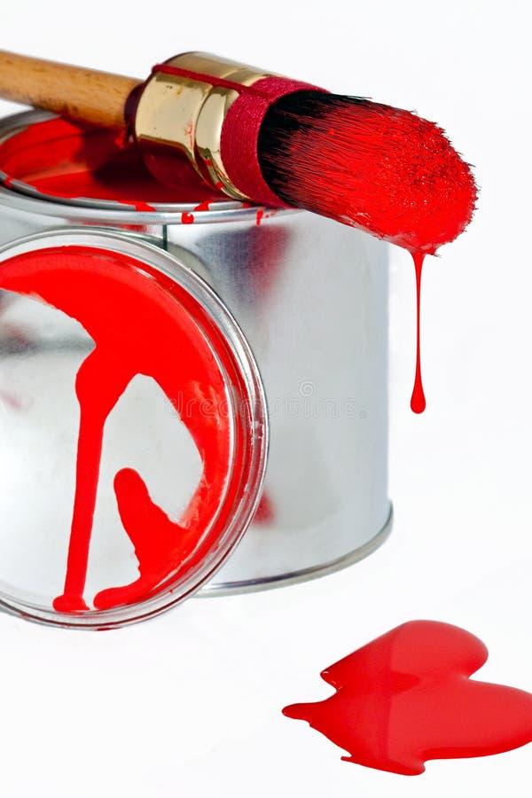 A pintura pode com a escova do gotejamento isolada no branco fotografia de stock