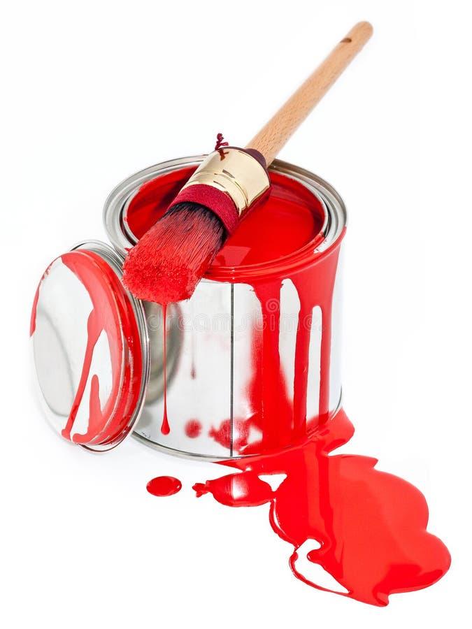 A pintura pode com a escova do gotejamento isolada no branco imagem de stock royalty free