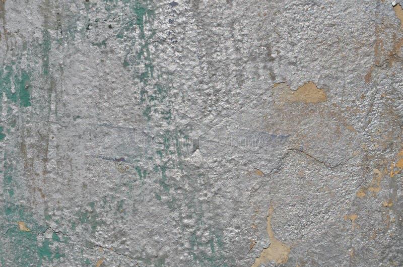 Pintura resistida dos grafittis da cor de prata no muro de cimento fotografia de stock