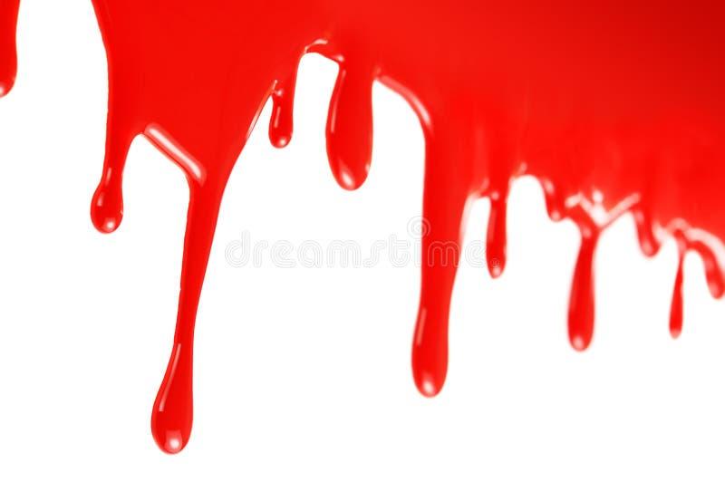 Pintura roja que fluye fotos de archivo