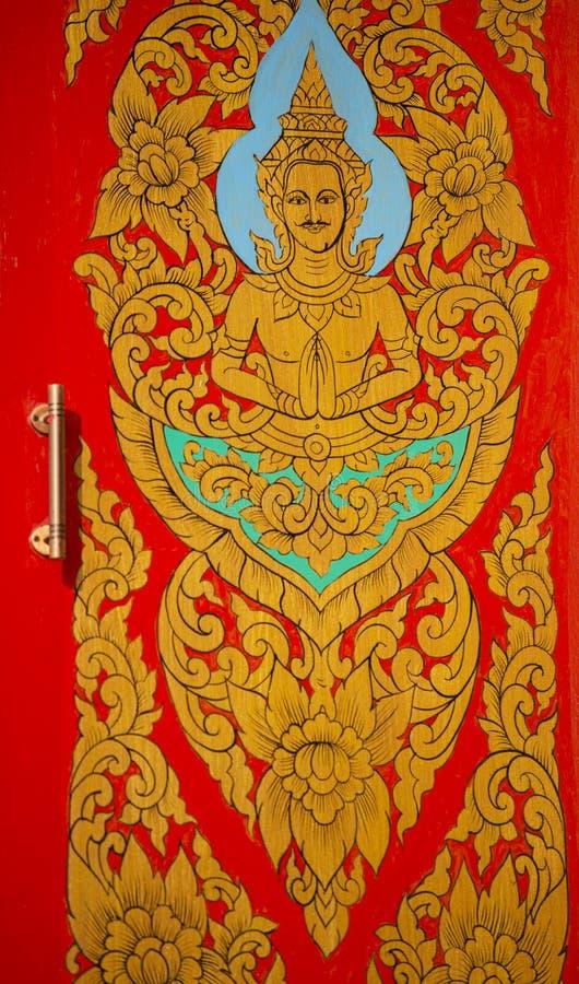 Pintura tailandesa tradicional del arte del estilo en puerta en templo imágenes de archivo libres de regalías