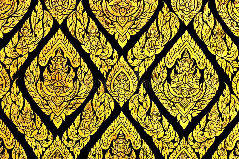 Pintura tradicional tailandesa excelente na janela do templo fotos de stock