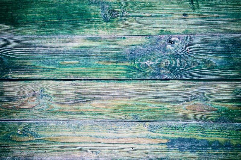 Pintura verde vieja en el fondo de madera wallpaper imagenes de archivo