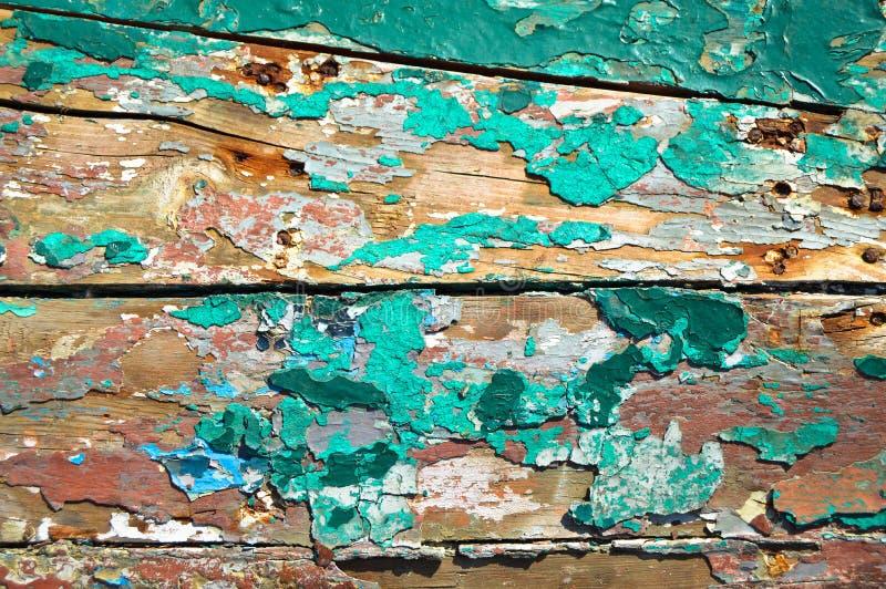 Pintura vieja quebrada en el panel de madera fotografía de archivo libre de regalías