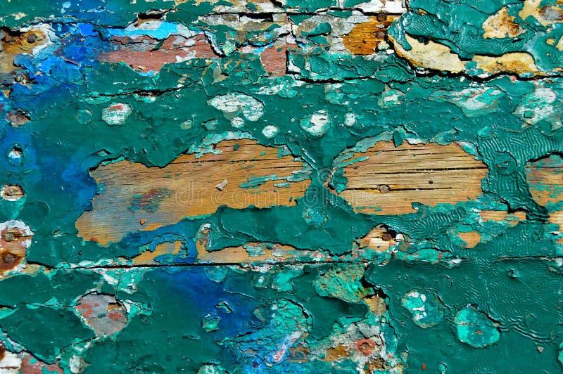Pintura vieja quebrada en el panel de madera imagen de archivo