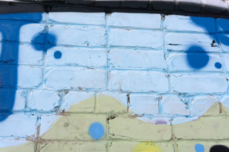 Pinturas abstratas dos grafittis na textura do ackground do muro de cimento imagem de stock
