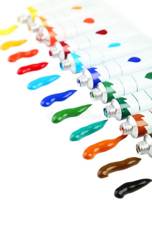 Pinturas acrílicas coloridas en tubos en el fondo blanco fotos de archivo libres de regalías