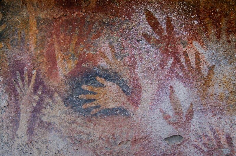 Pinturas de caverna antigas no patagonia fotografia de stock royalty free