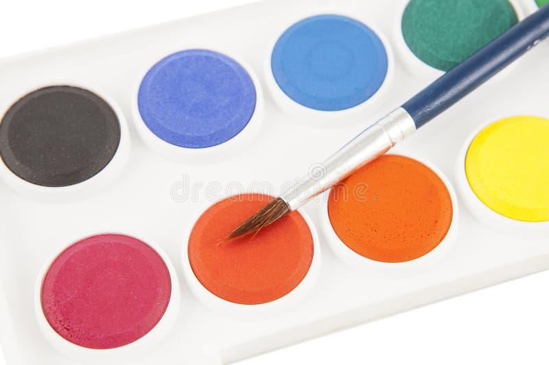 Pinturas e pincel de Colourfull fotografia de stock royalty free