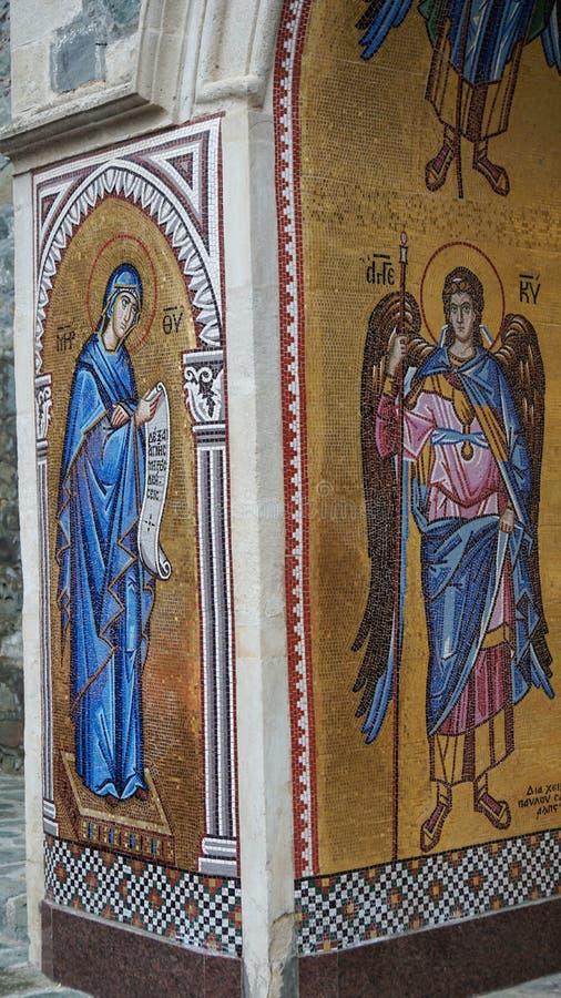Pinturas murais da textura de mosaico em Chipre na parede na igreja foto de stock