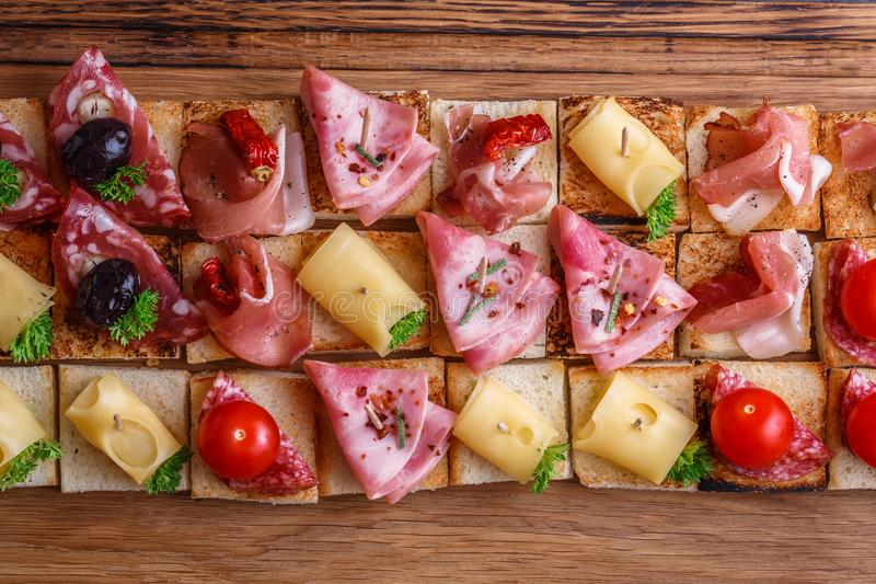 Pintxos, tapas, spanish canapes party finger food background. Pintxos, tapas, spanish canapes party finger food background stock photo