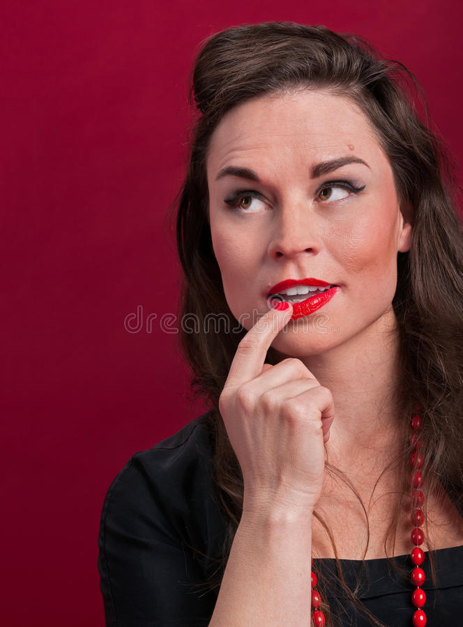 Pinup Girl Deep In Thought Stock Photo