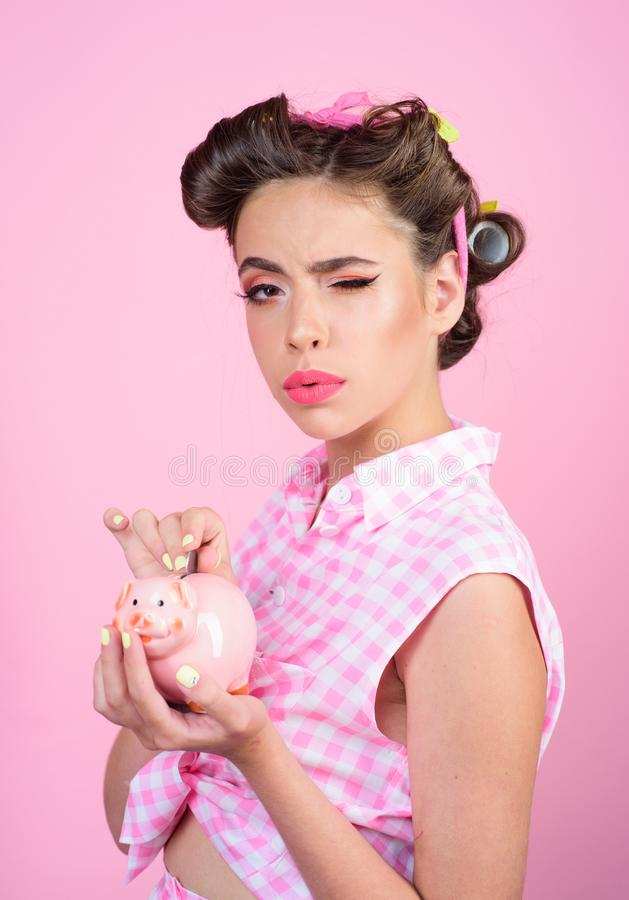 Pinup girl with fashion hair. pretty girl in vintage style. pin up woman with trendy makeup. loan. Money. Housewife stock photo