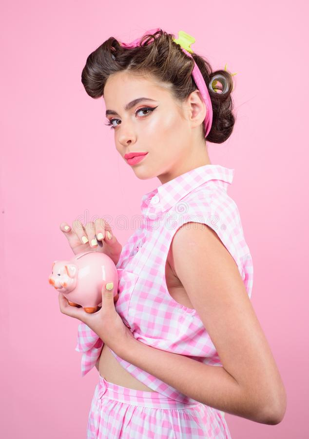Pinup girl with fashion hair. pretty girl in vintage style. pin up woman with trendy makeup. loan. Money. Housewife royalty free stock photo