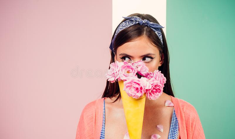 Pinup girl with fashion hair. girl in vintage style. pin up woman with trendy makeup. flower bouquet. Florist. Summer. Retro woman eating ice cream from stock images