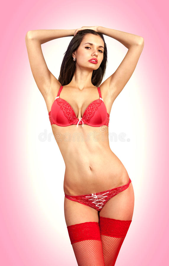 Pinup girl in red underwear stock images