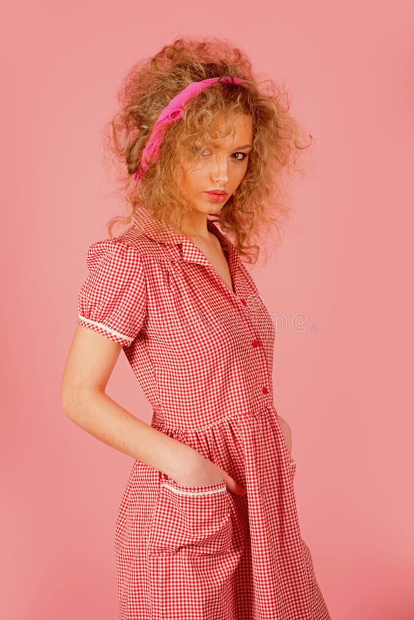 Pinup girl vintage with curly hair. Pretty woman pinup style in retro fashion dress. Curly is beautiful.  stock photos