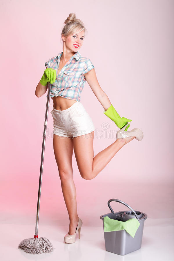 Pinup girl Woman housewife cleaner portrait stock photography