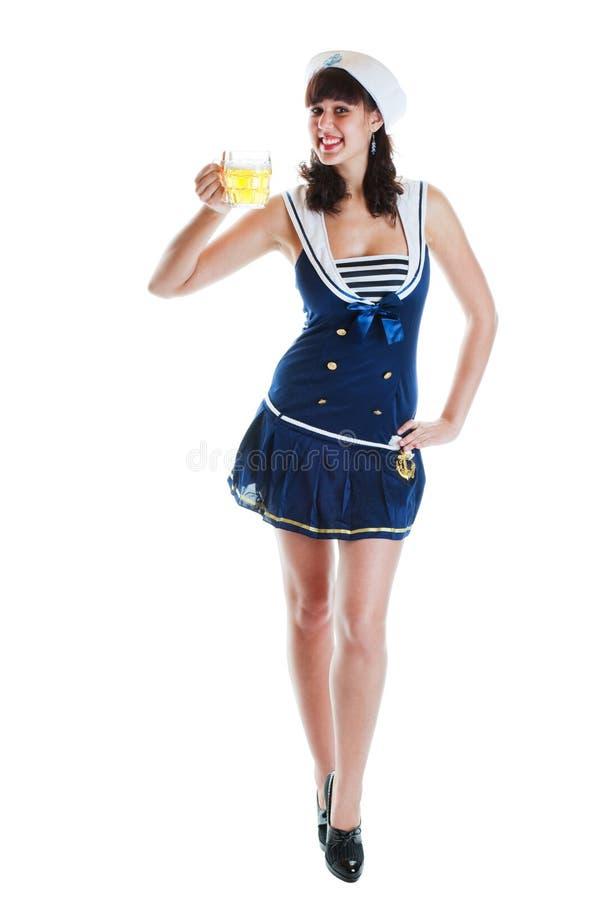Pinup Seemann-Mädchen mit Bier stockfotografie