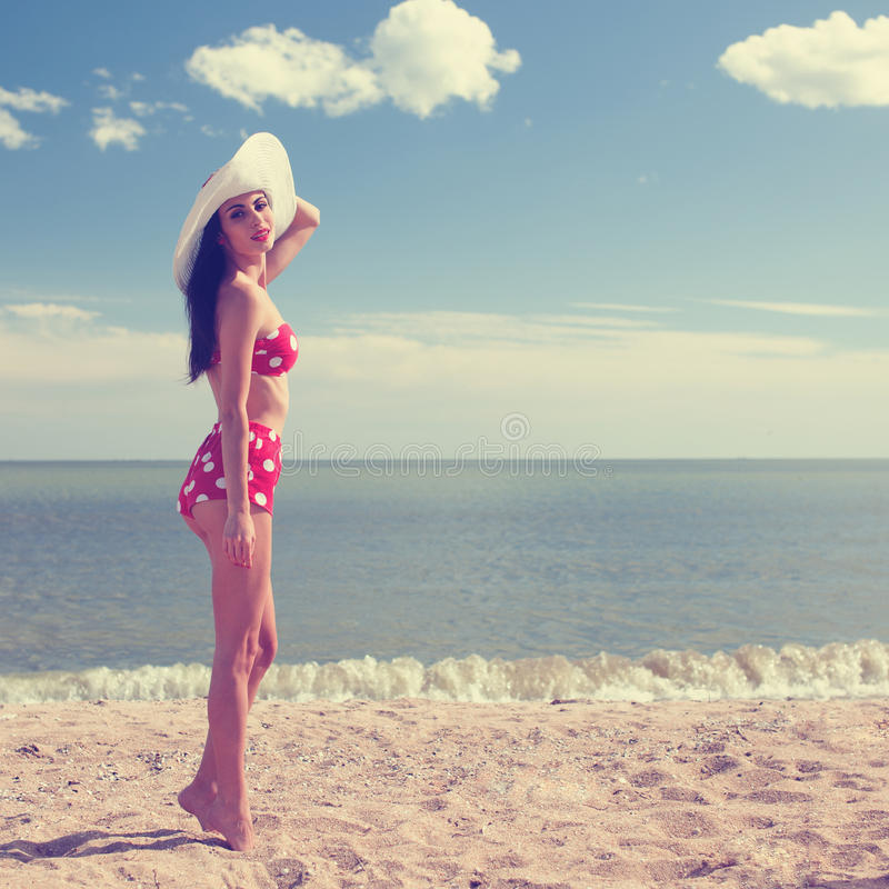 Pinup styled woman. At the beach stock images
