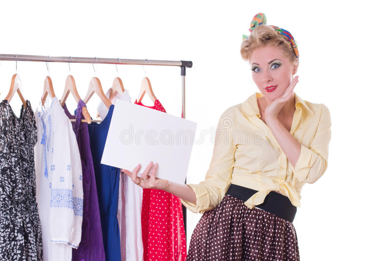 Pinup woman holding blank note over hanger and dresses royalty free stock photo