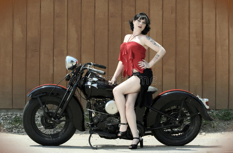 Pinup Woman and Motorcycle royalty free stock images