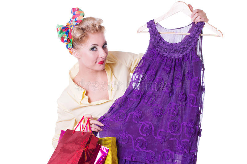 Pinup woman showing dresses with shopping bags stock photos