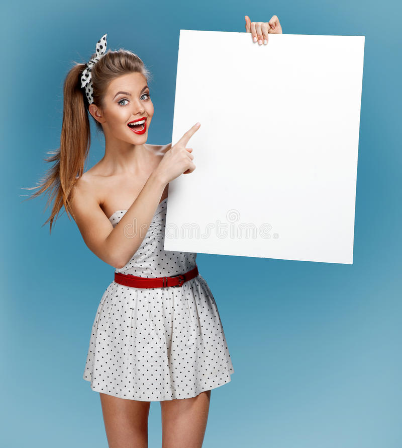 Pinup woman shows forefinger hand on the blank banner royalty free stock photos
