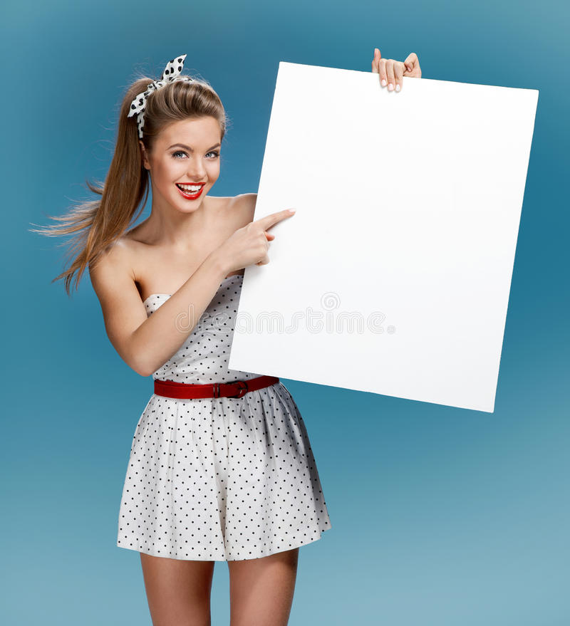 Pinup woman shows forefinger hand on the blank banner stock photography
