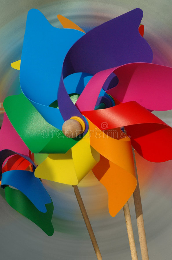 Pinwheel. Colorful pinwheel against abstract background royalty free stock images