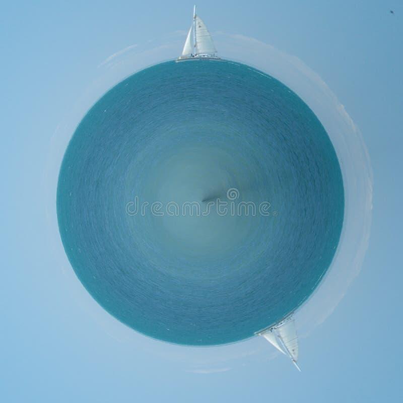 Pinwheel of sailboat and reflection royalty free stock photo