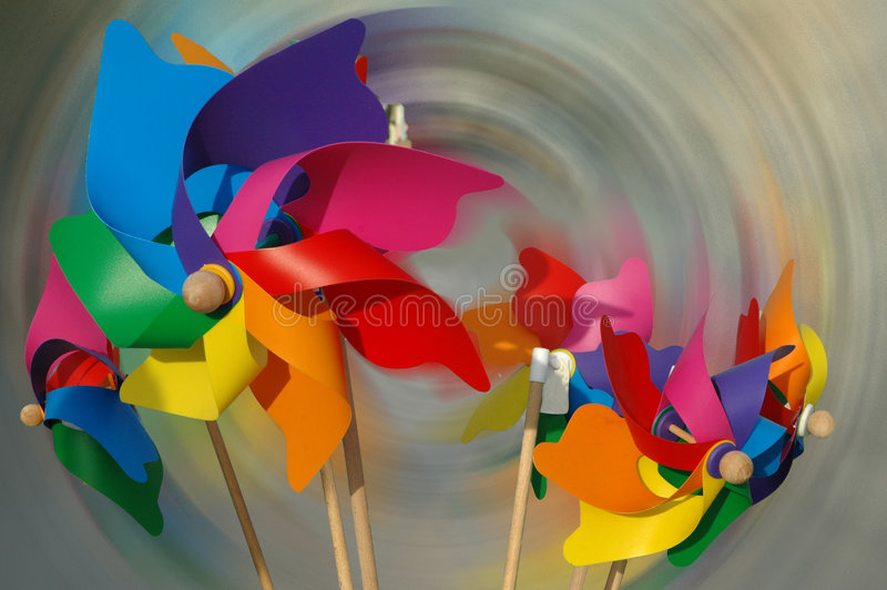 Pinwheels. Colorful pinwheels against abstract background stock image