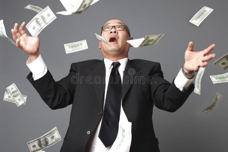 Pioggia delle cento fatture del dollaro immagine stock