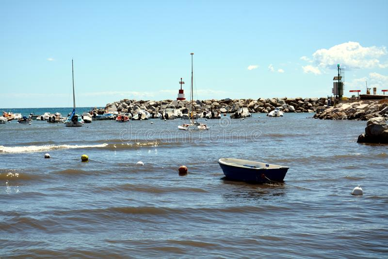 Piombino and rocks, view at Livorno, Tuscany, Italy, Europe. Piombino town, view of Tyrrhennian sea and waves, boats, rocks and beautiful landscape in Livorno stock photos