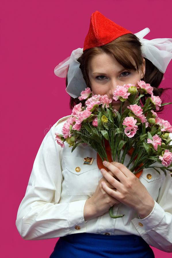 The pioneer with flower on a pink background royalty free stock photography