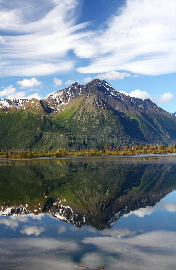 Pioneer Peak. Alaska Chugach Mountains Pioneer Peak with nice clouds and Reflection stock images