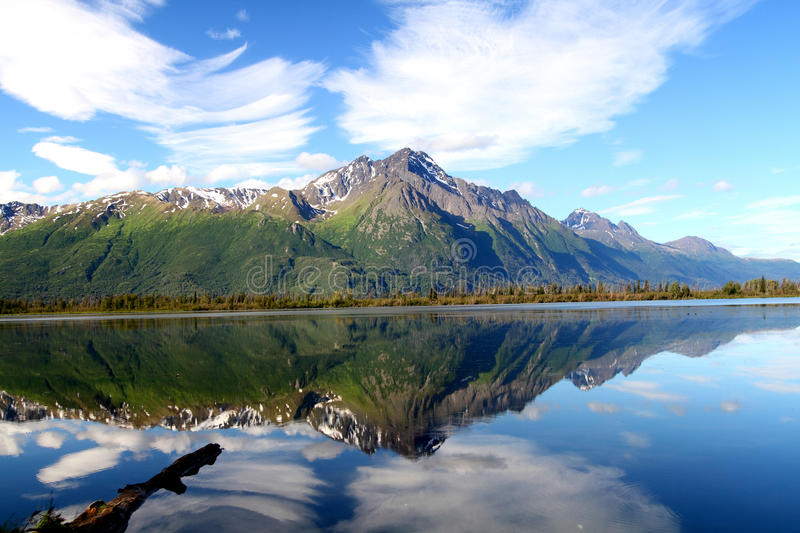 Pioneer Peak Reflected. With wonderful clouds stock images