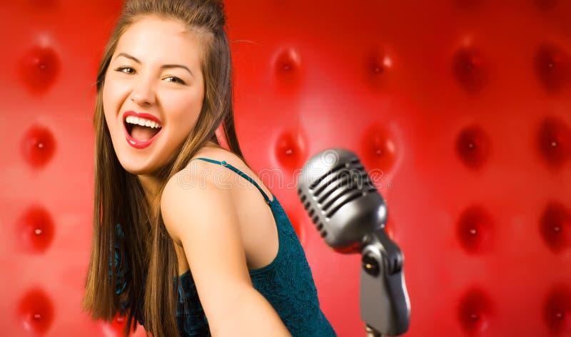 piosenkarza kobiety potomstwa fotografia stock