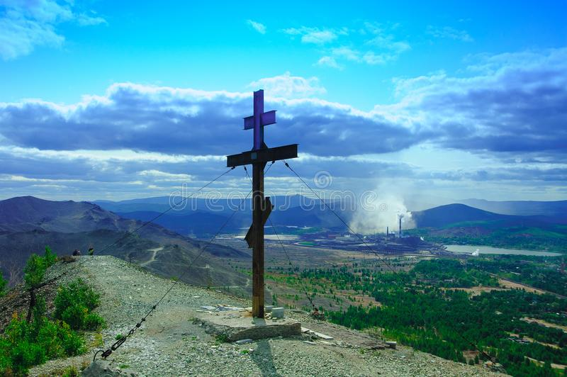 Pious cross on the mountain, Karabash. Karabash, Russia - August 2018: Poklonniy cross on the mountain. Horizontal orientation. Editorial use only royalty free stock images