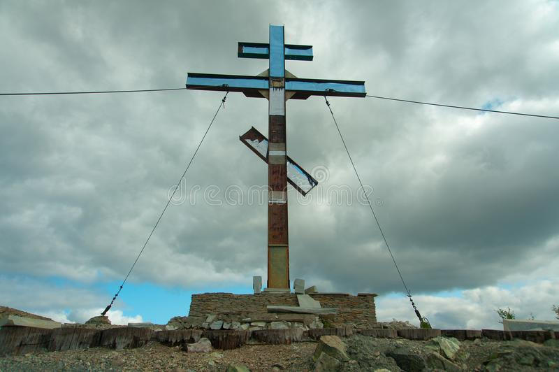 Pious cross on the mountain, Karabash. Karabash, Russia - August 2018: Poklonniy cross on the mountain. Vertical orientation. Editorial use only royalty free stock images