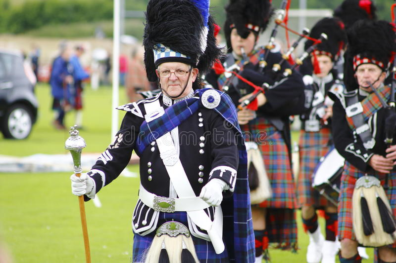 Pipe band at Newtonmore highland games stock image