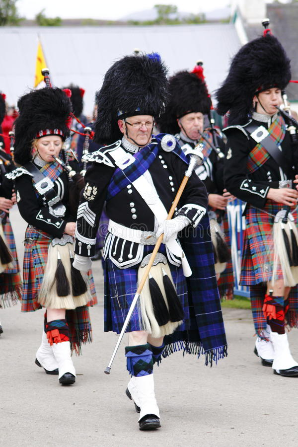 Pipe band at Newtonmore highland games stock photography