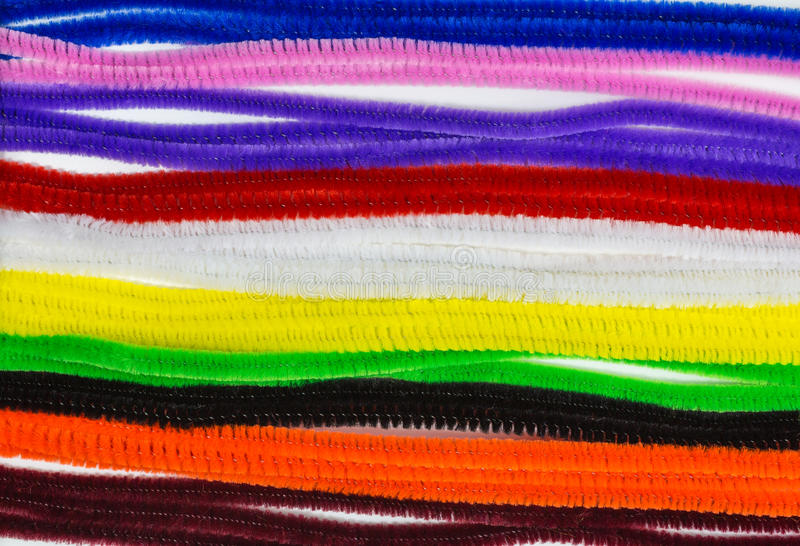 Pipe cleaners. Background of multicolored pipe cleaners stock image