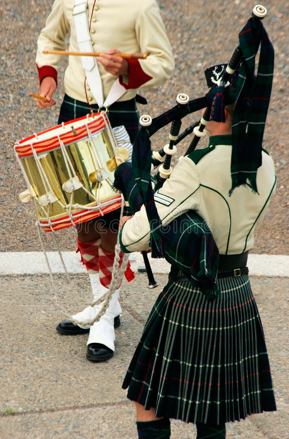 Pipe and Drum. A piper and a drummer are displayed stock images