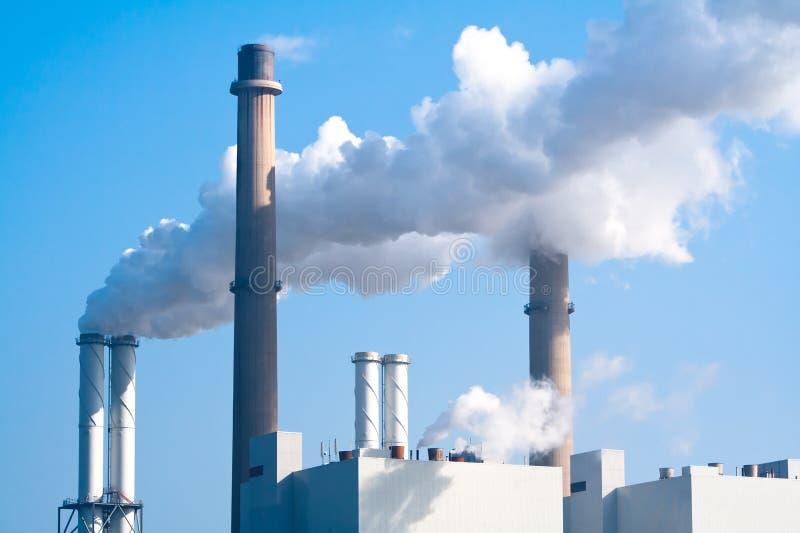 Pipe factory smoke emission. Smoke emission from a large energy plant stock image