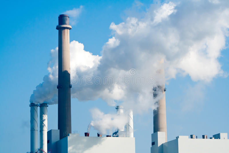 Pipe factory smoke emission. Smoke emission from factory pipes royalty free stock photography
