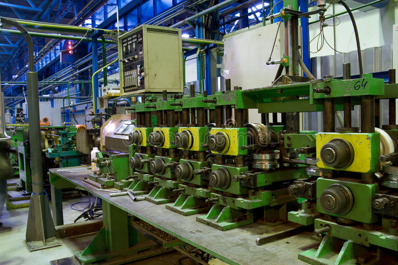 Download Pipe Making Machine At Work Stock Photo - Image of many, plant: 6991116