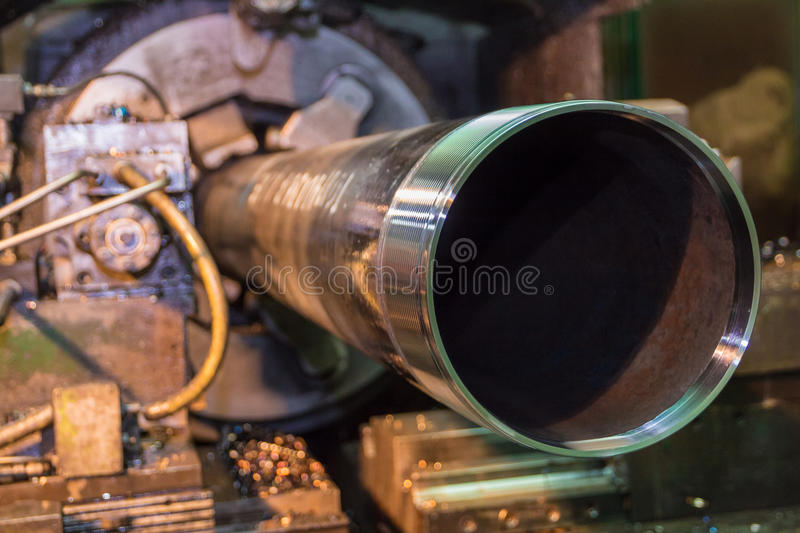 Pipe making by the threading machine royalty free stock photos