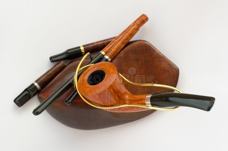 Pipe with mouthpieces. Smoking pipe with a holder and some mouthpieces royalty free stock images