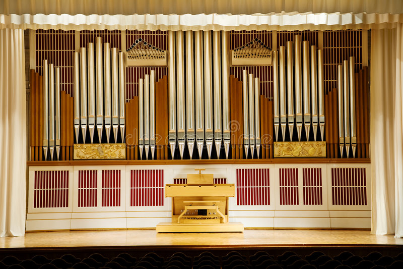 Pipe organ. A view of the pipes of a large pipe organ stock photos